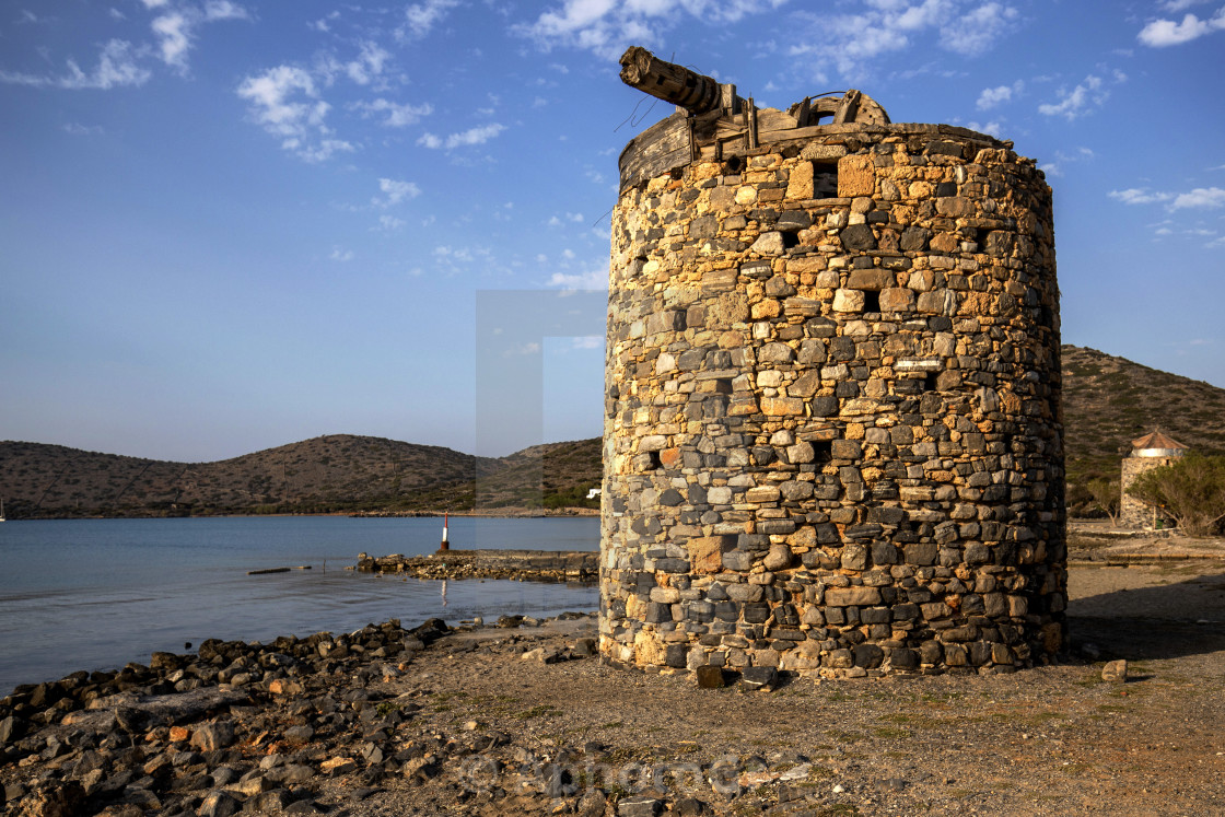 """Old abandoned windmill at Elounda"" stock image"