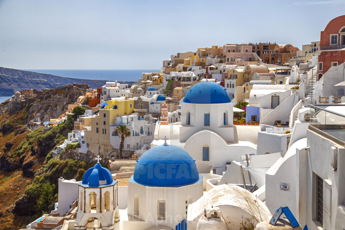 """Blue domes of Oia - Santorini Greece"" stock image"