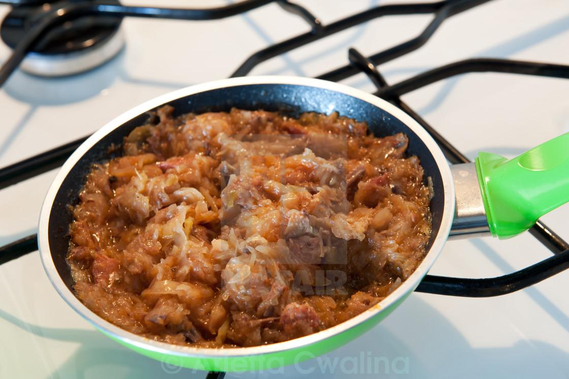 """Frying pan with hot Polish bigos"" stock image"