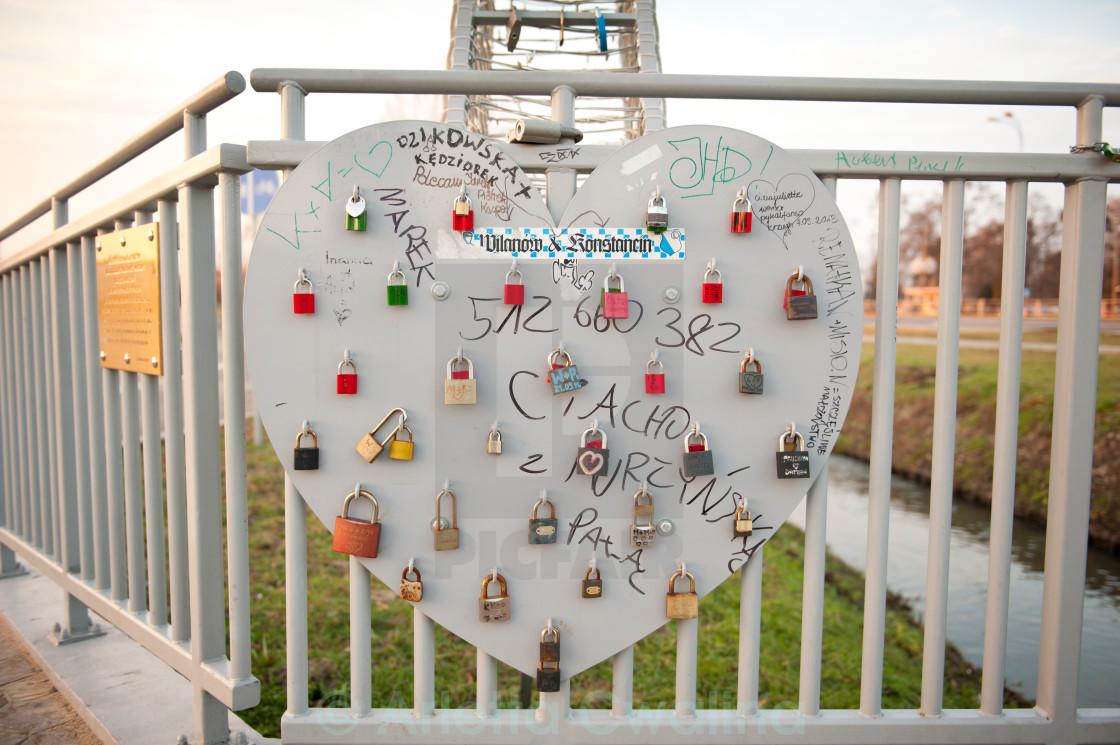 love padlocks on metal heart - License, download or print