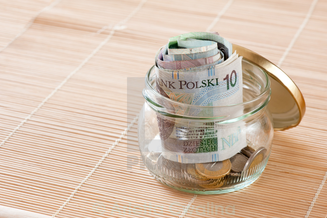 """Money savings in glass jar"" stock image"