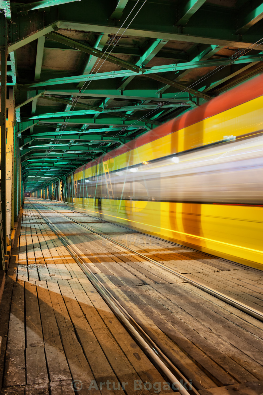 """Abstract Tram Light Trail on a Bridge"" stock image"