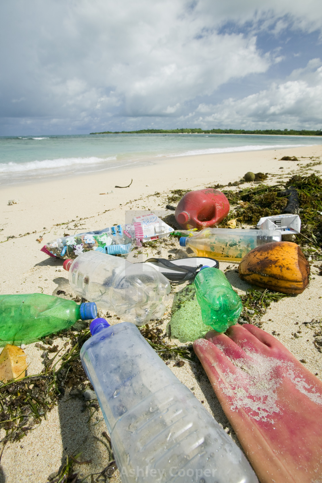 """Plastic rubbish washed up on Nantandola Beach on Fiji"" stock image"