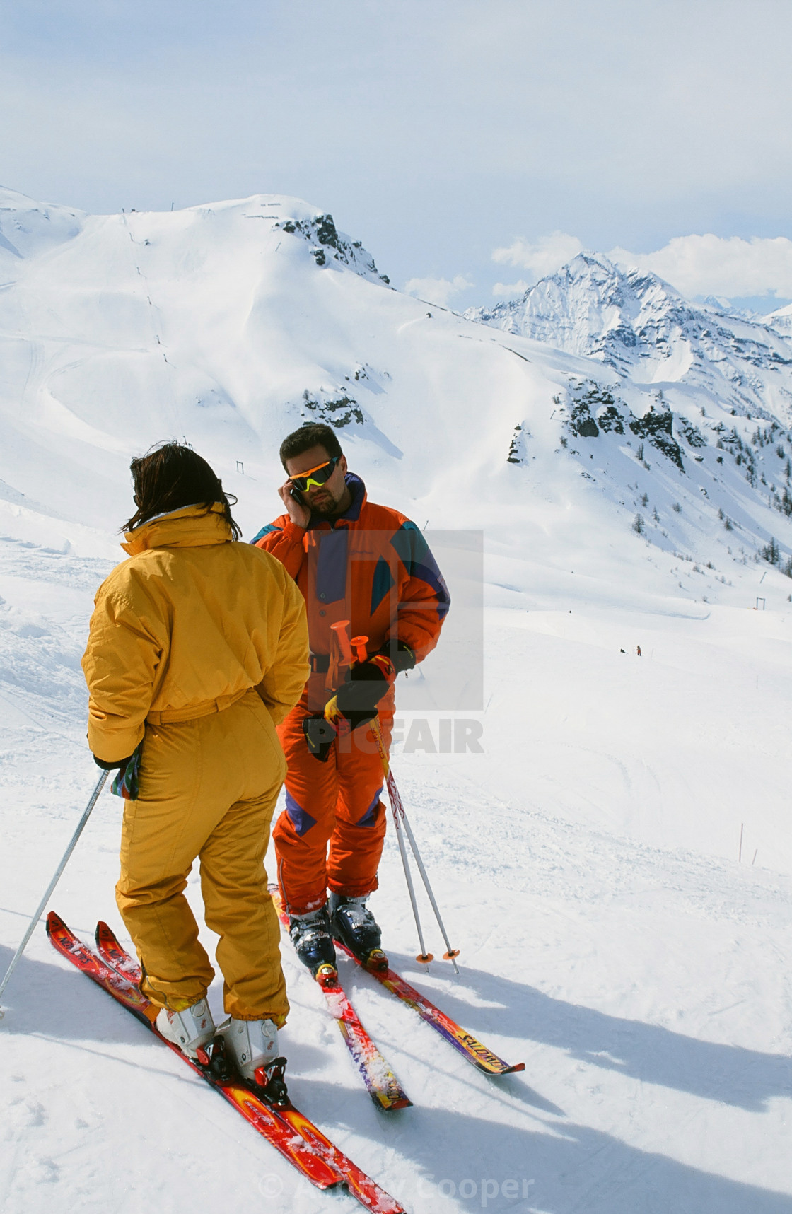 """A skier using his mobile phone in France"" stock image"