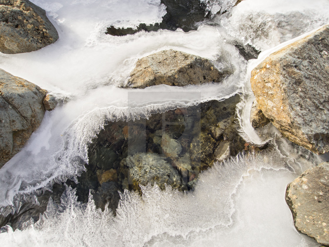 """Grains Ghyll in Borrowdale, Lake District, UK, frozen over during a cold..."" stock image"