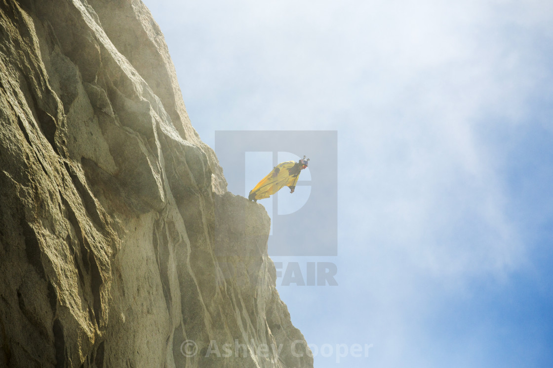 """A base jumper wearing a wing suite jumps from the Aiguille Du Midi above..."" stock image"
