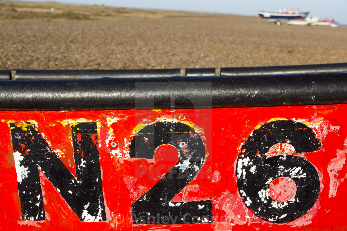 """A number on a boat on the beach at Cley, Norfolk, UK."