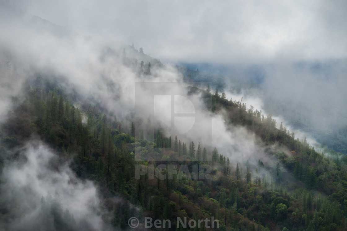 """Fog on a Mountain as a Storm Passes Overhead"" stock image"