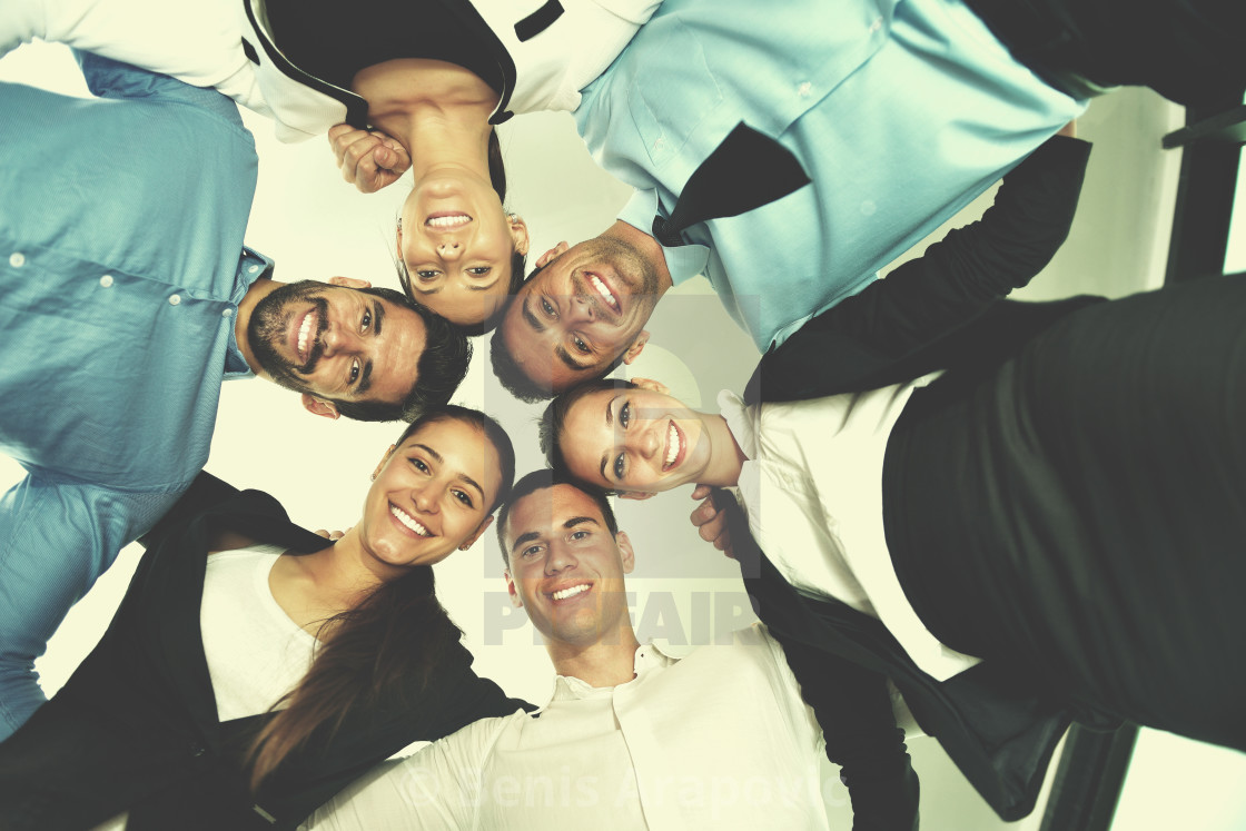"""business people with their heads together"" stock image"
