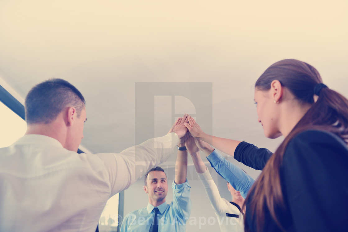 """business people group joining hands"" stock image"