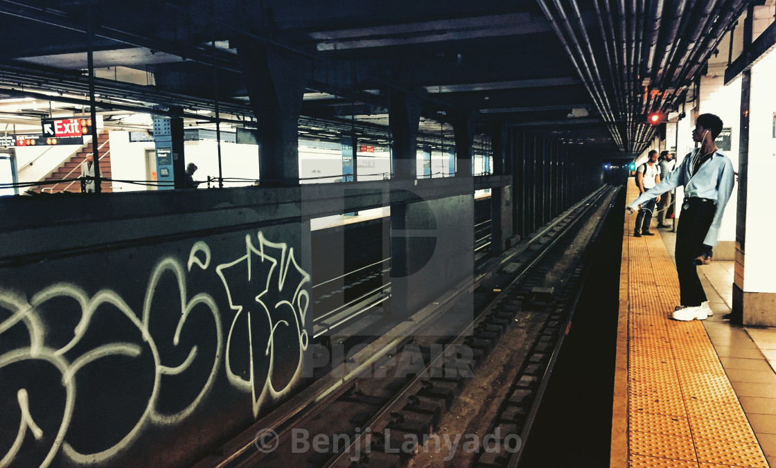 """Delancey St / Essex St F Train Platform"" stock image"