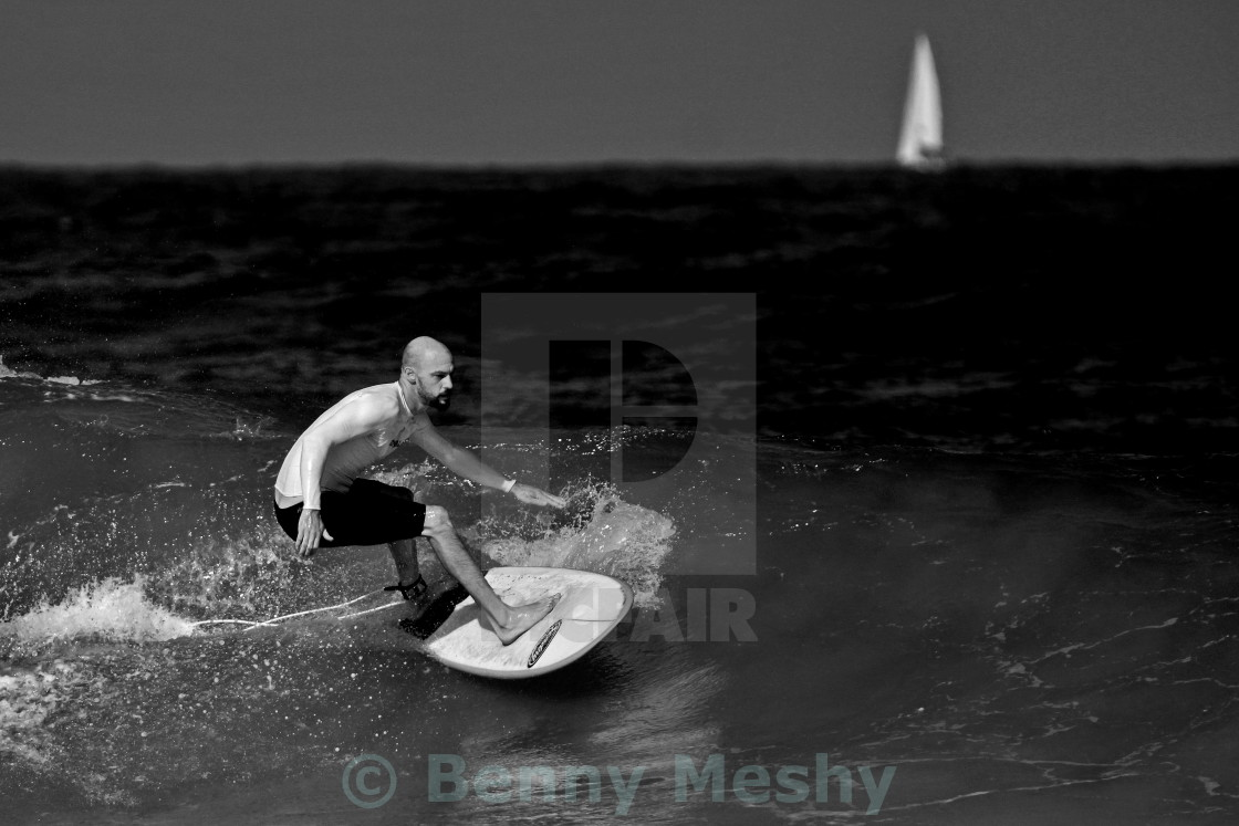 """A surfer and a boat"" stock image"