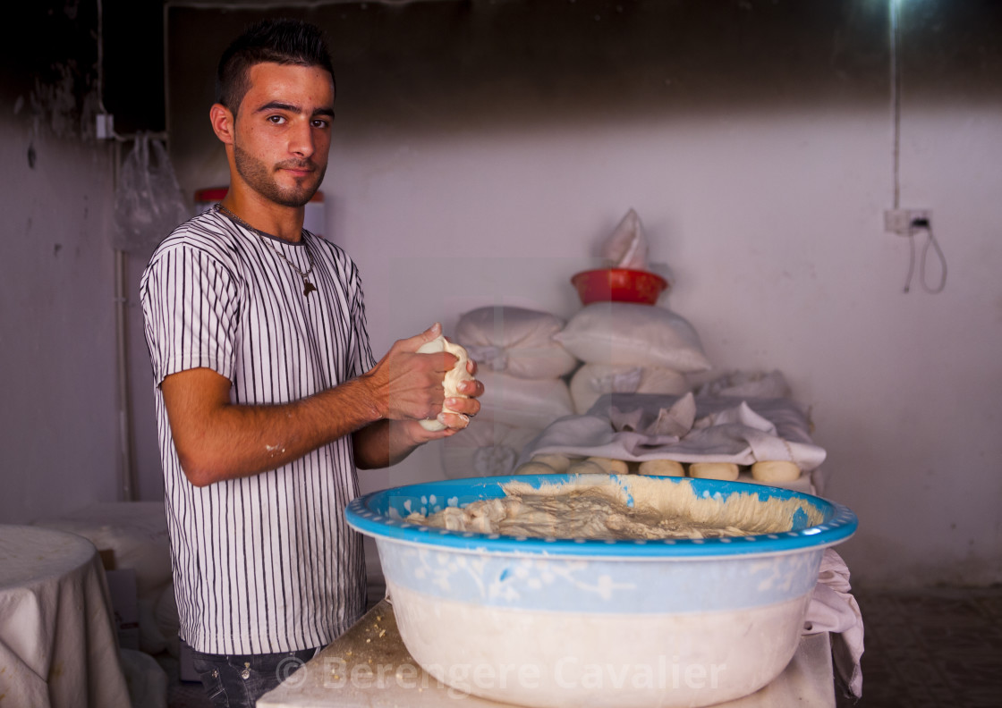 """Man in a bakery making bread, Akre, Kurdistan, Iraq"" stock image"