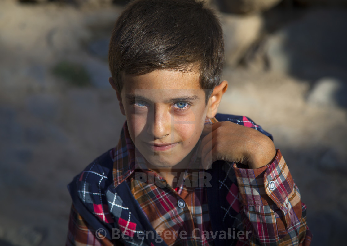 """Kurdish Child With Blue Eyes, Palangan, Iran"" stock image"