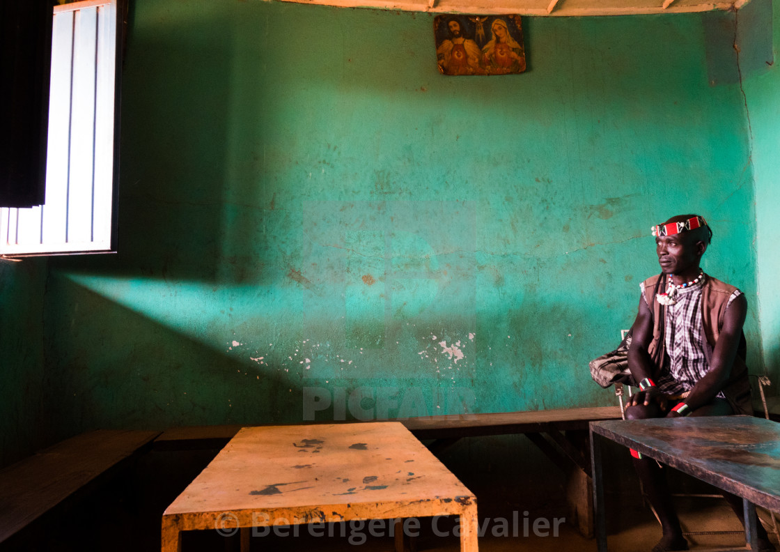"""Man inside a bar in Key Afer, Omo Valley, Ethiopia"" stock image"
