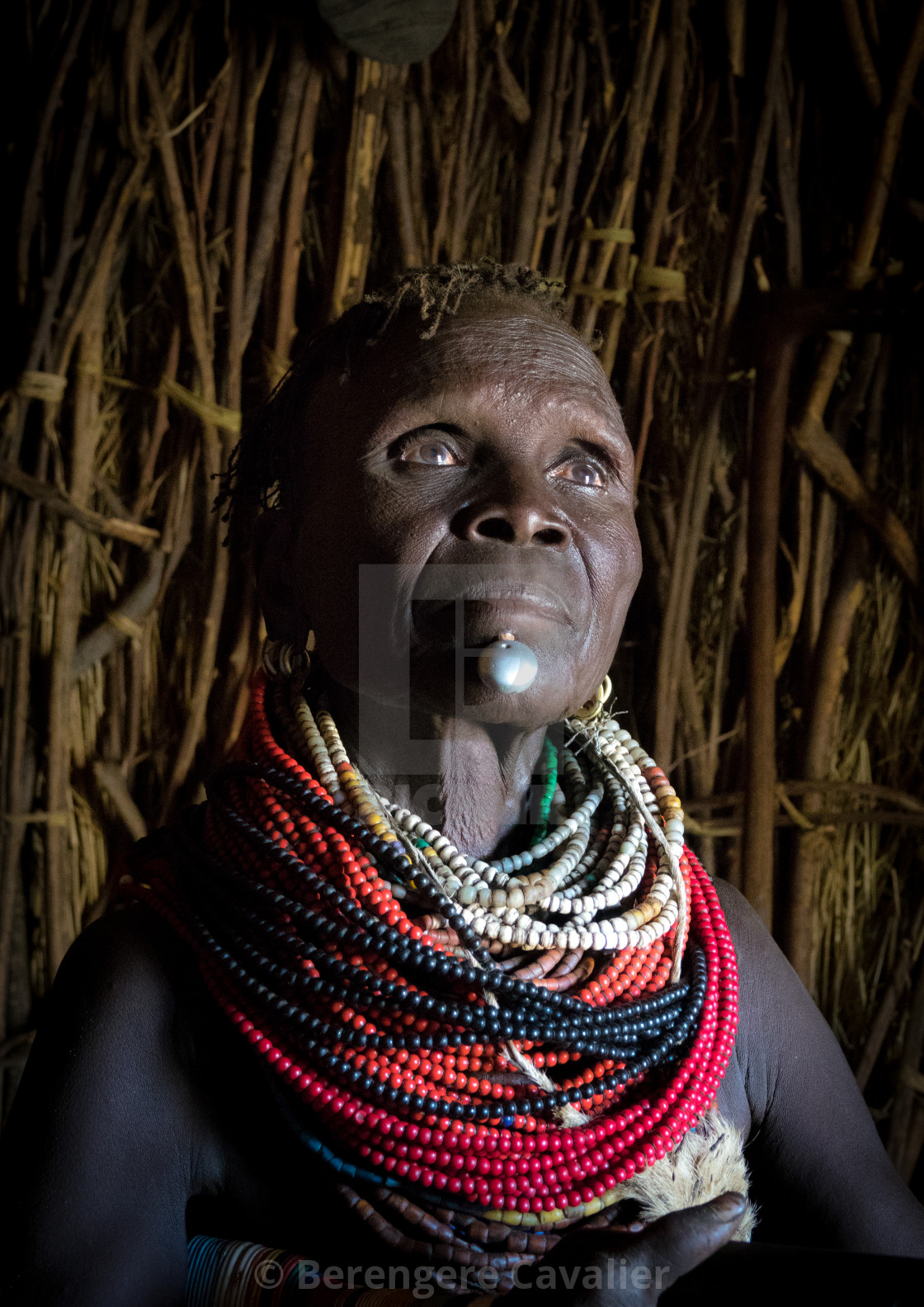 """Old Nyangatom woman in her hut, Kangate, Omo Valley, Ethiopia"" stock image"