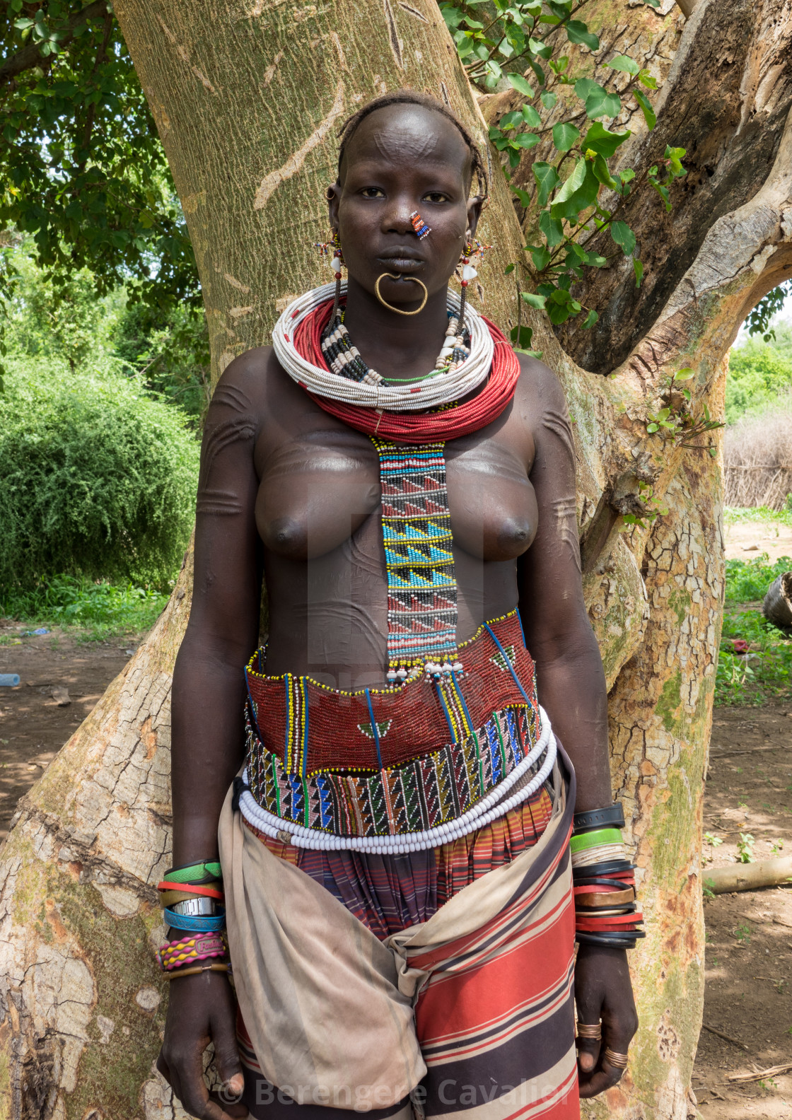 """Sudanese Toposa tribe girl refugee in Kangate, Omo Valley, Ethiopia"" stock image"