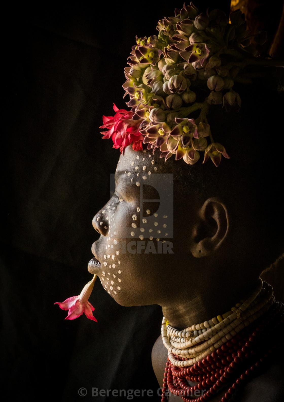 """Karo tribe kid with flowers decorations, Korcho, Omo valley, Ethiopia"" stock image"