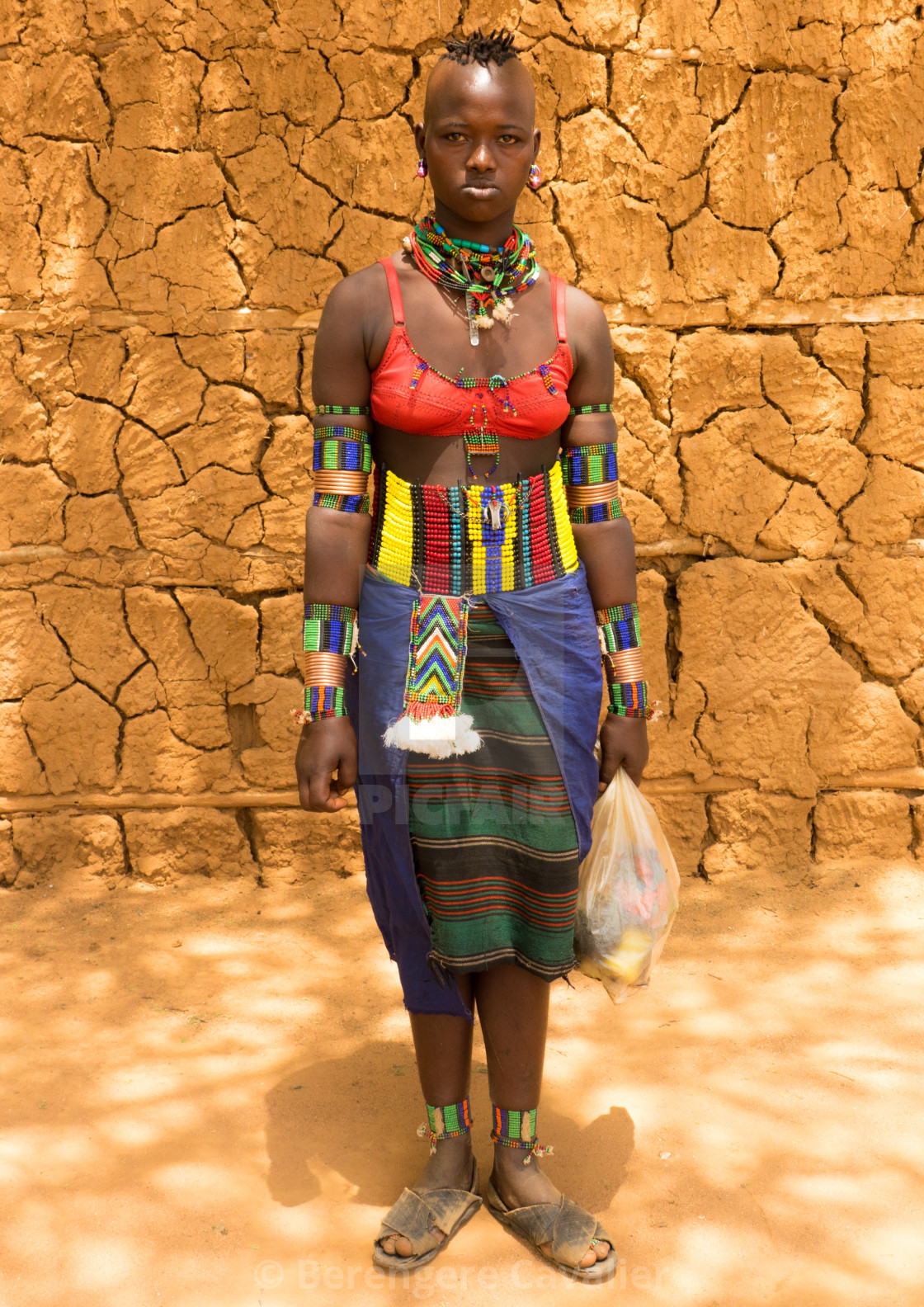 """Stylish Bana girl going to Key Afer market, Omo Valley, Ethiopia"" stock image"
