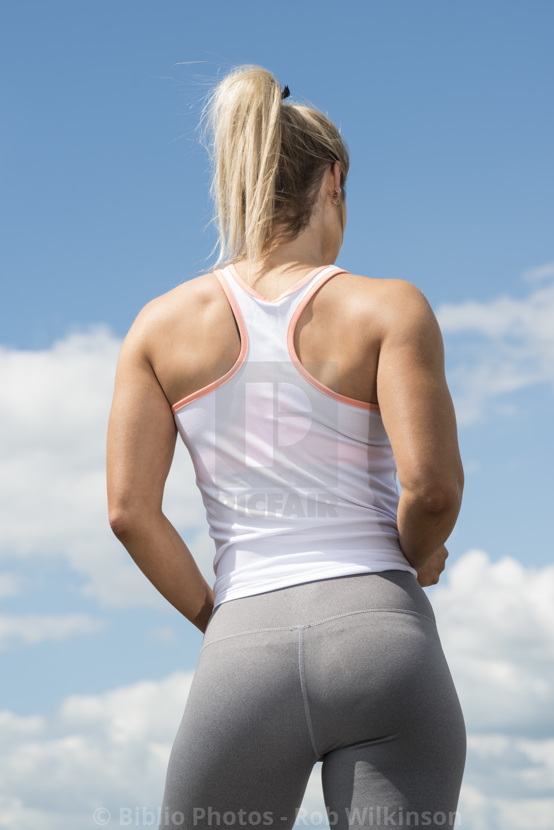 """fit woman wearing leggins back view"" stock image"