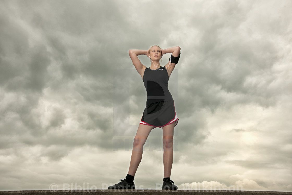 """woman resting after a run exercising"" stock image"