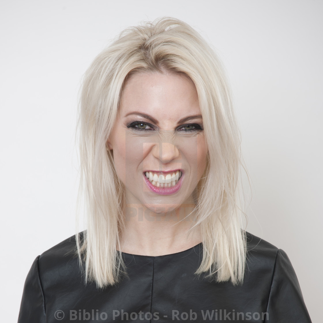 """blonde woman angry"" stock image"