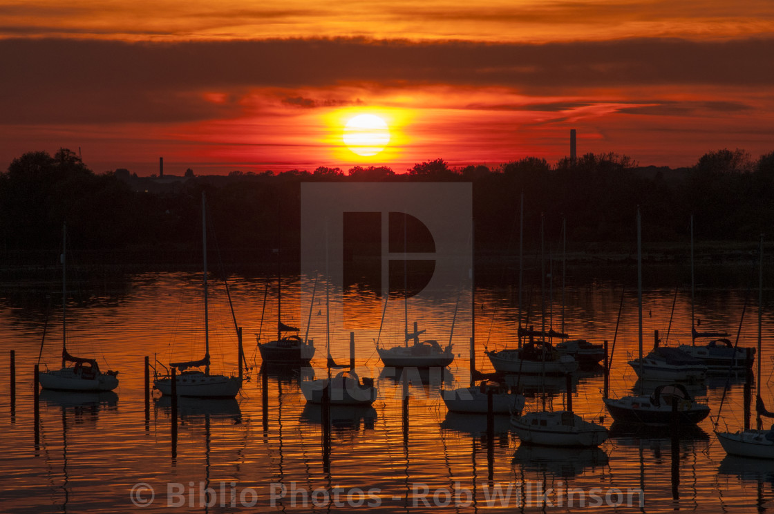 """boats moored at sunset"" stock image"