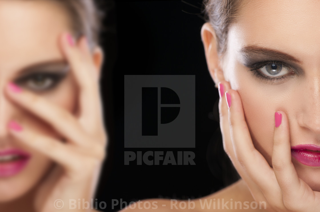 """close up of hot pink perfect make up on a models face"" stock image"