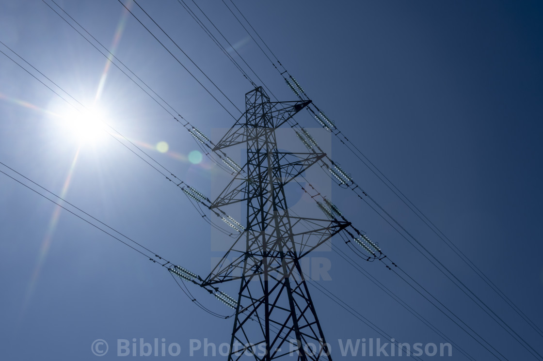"""electricity pylon with lens flare"" stock image"