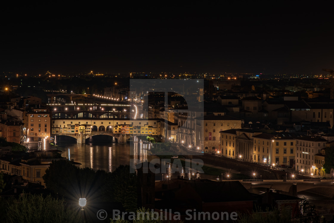 """Night view of Ponte Vecchio on the Arno river"" stock image"