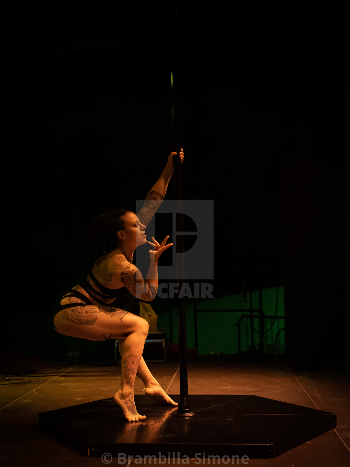 Pole dance dancer performs on stage
