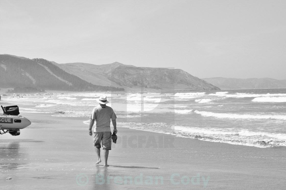 """Man on Beach"" stock image"