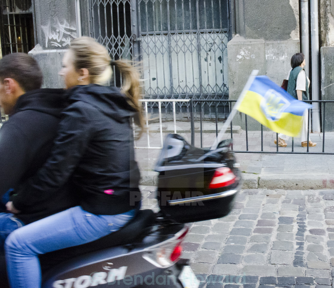 Ride on moped with Ukrainian flag