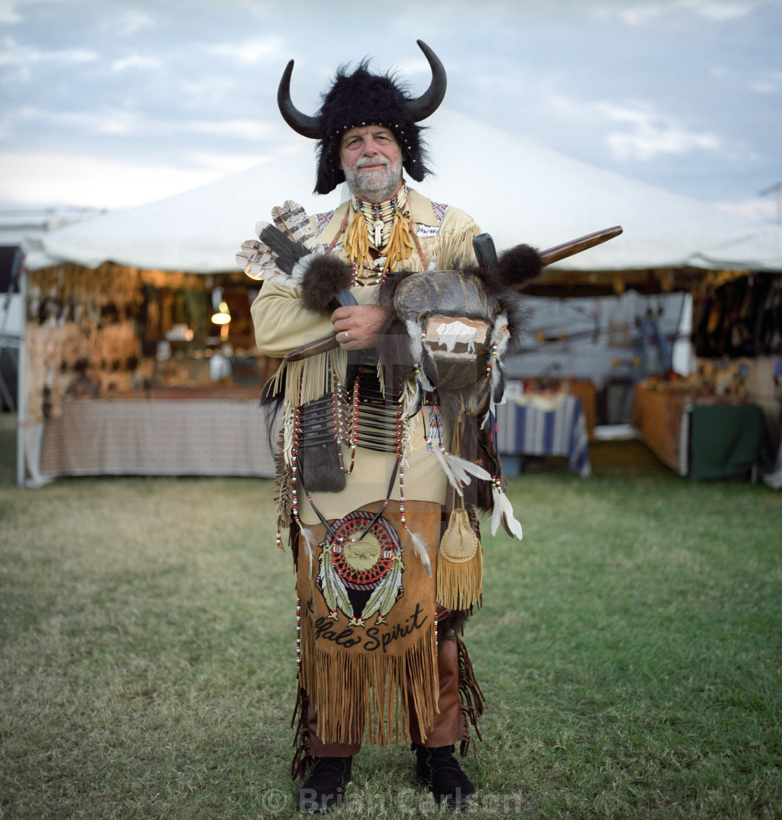 """Portrait of man wearing traditional Native American clothing at a pow wow in..."" stock image"