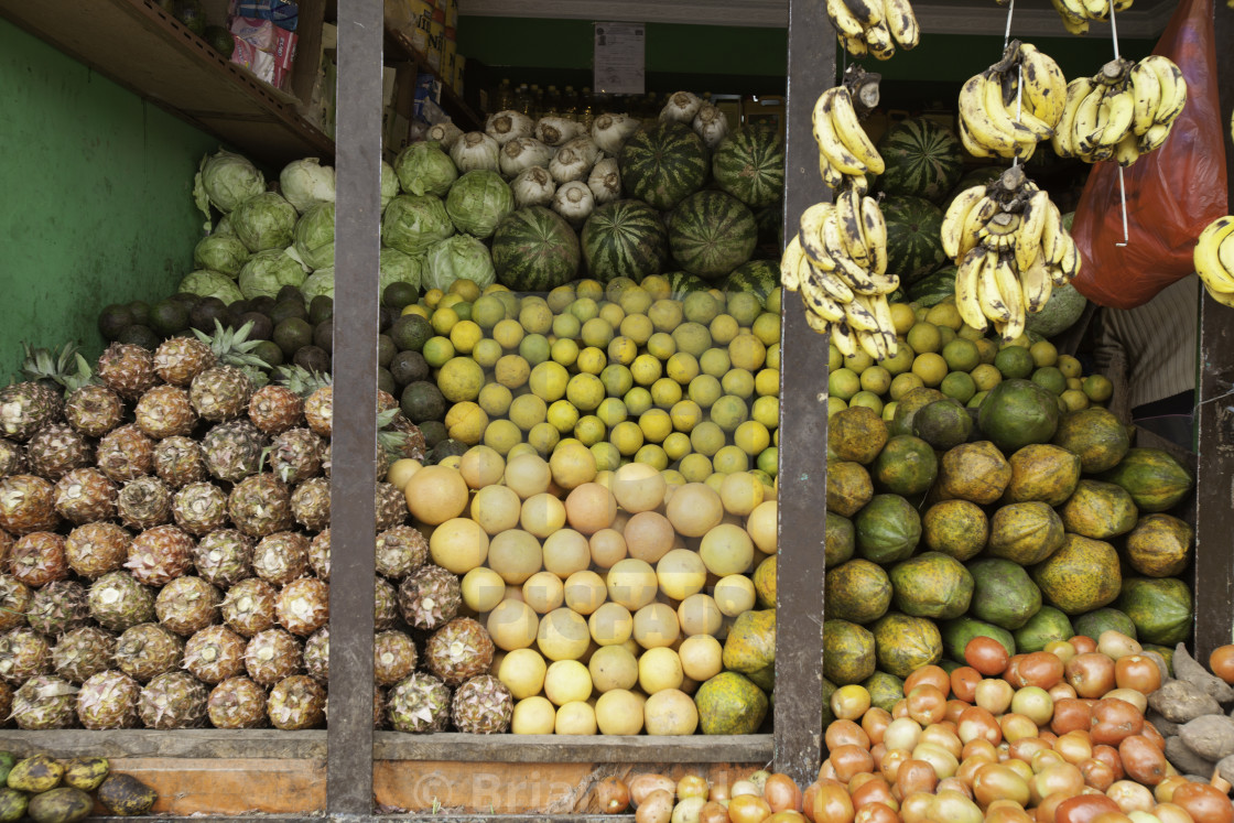 """fruit stacked up at a fruit stand in Addis Ababa, Ethiopian"" stock image"