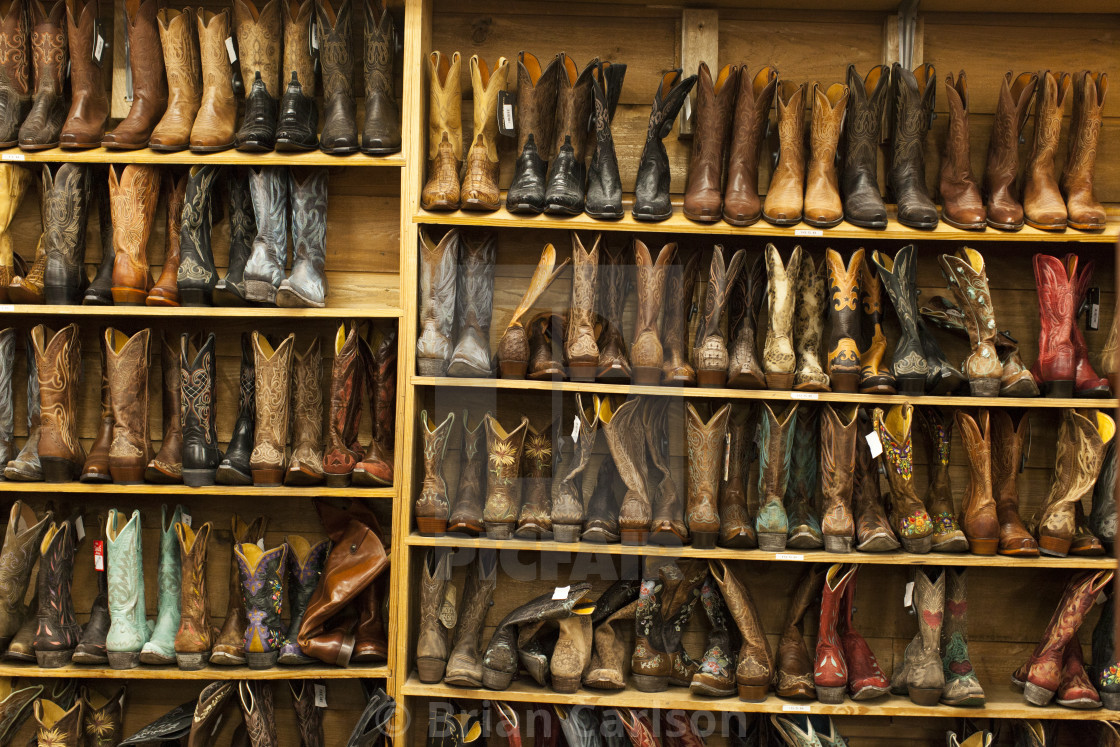 """boots lined up on a shelf"" stock image"