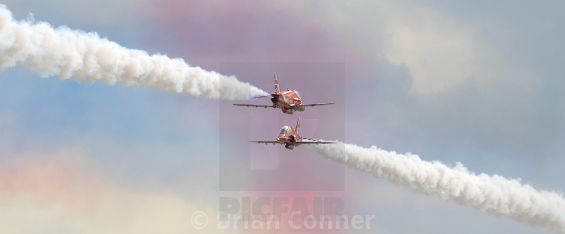 """RAF Red Arrows colourful crossover"" stock image"