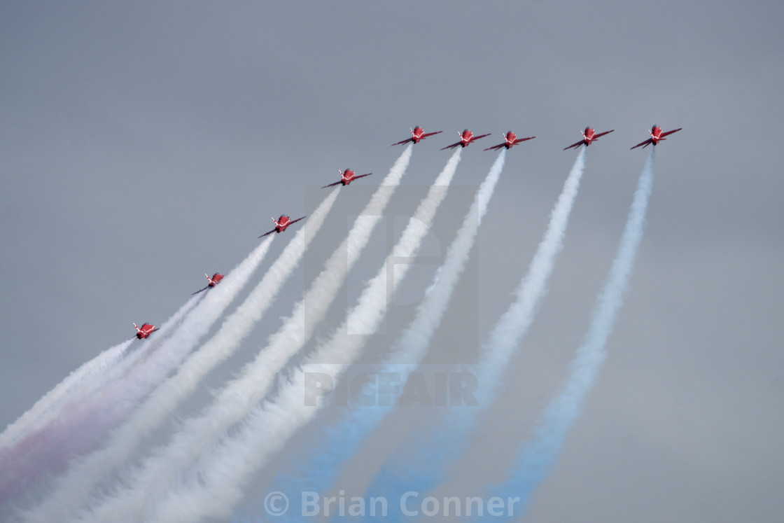 """Red Arrows into a grey sky"" stock image"