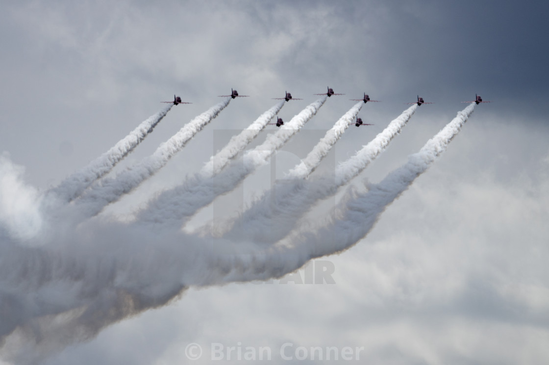 """Red Arrows with dramatic smoke trails"" stock image"