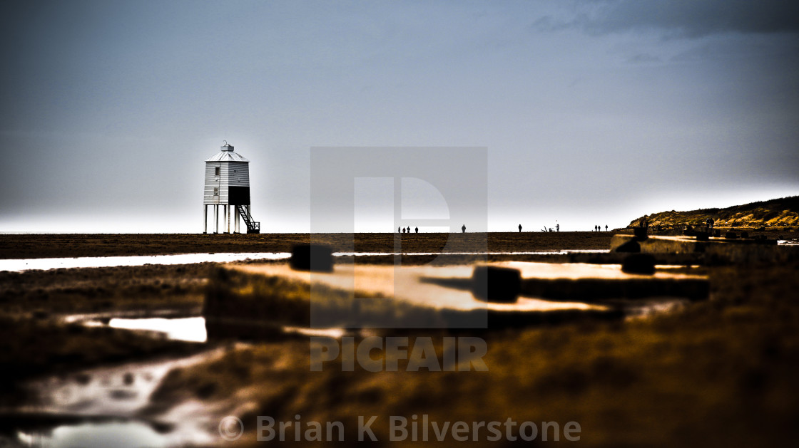 """Burnham Lighthouse from the Tank Traps"" stock image"