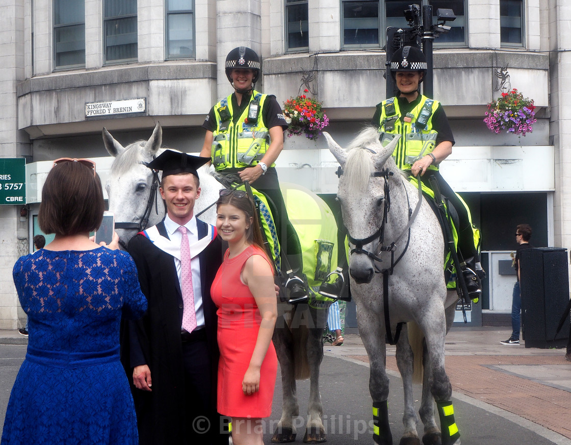 """New graduates pose for photos, Cardiff, Wales."" stock image"