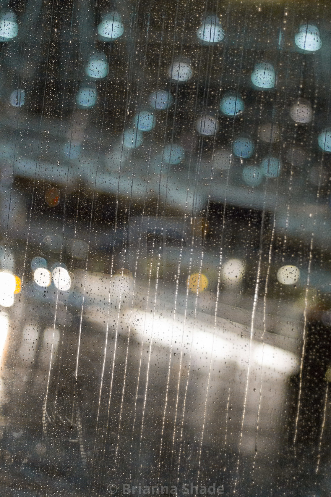 """Blurred lights through a rainy window"" stock image"