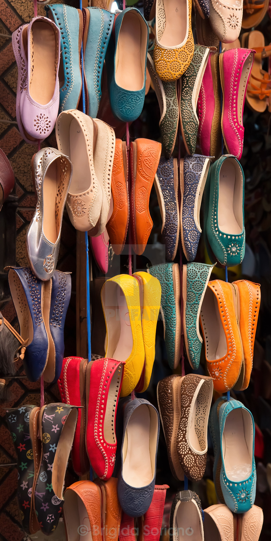 """Moroccan colourful leather shoes on display"" stock image"