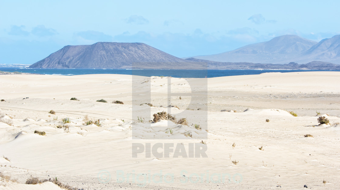 """Dunes, Sand, Sea and Volcano in Fuerteventura"" stock image"