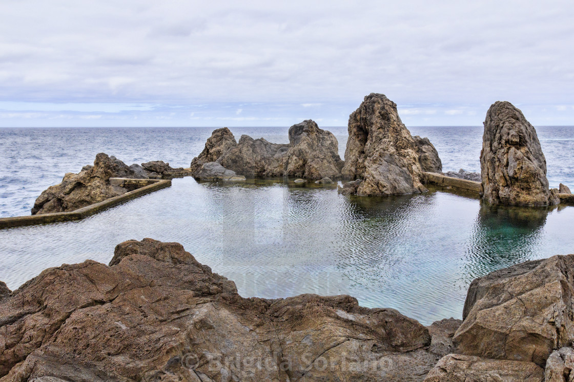 """Natural lava rock pool and sea in Porto Moniz in Madeira"" stock image"