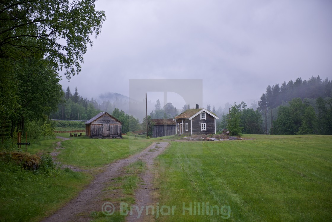 """Timber house in mist"" stock image"