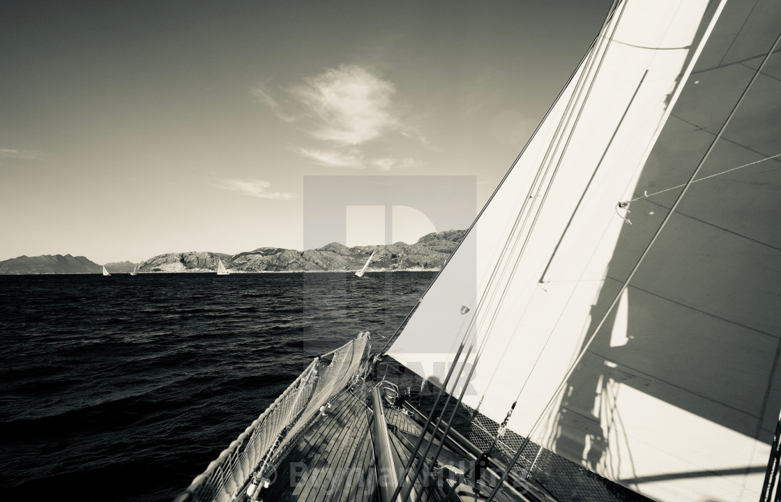 """""""Sailboat with wind in sails"""" stock image"""