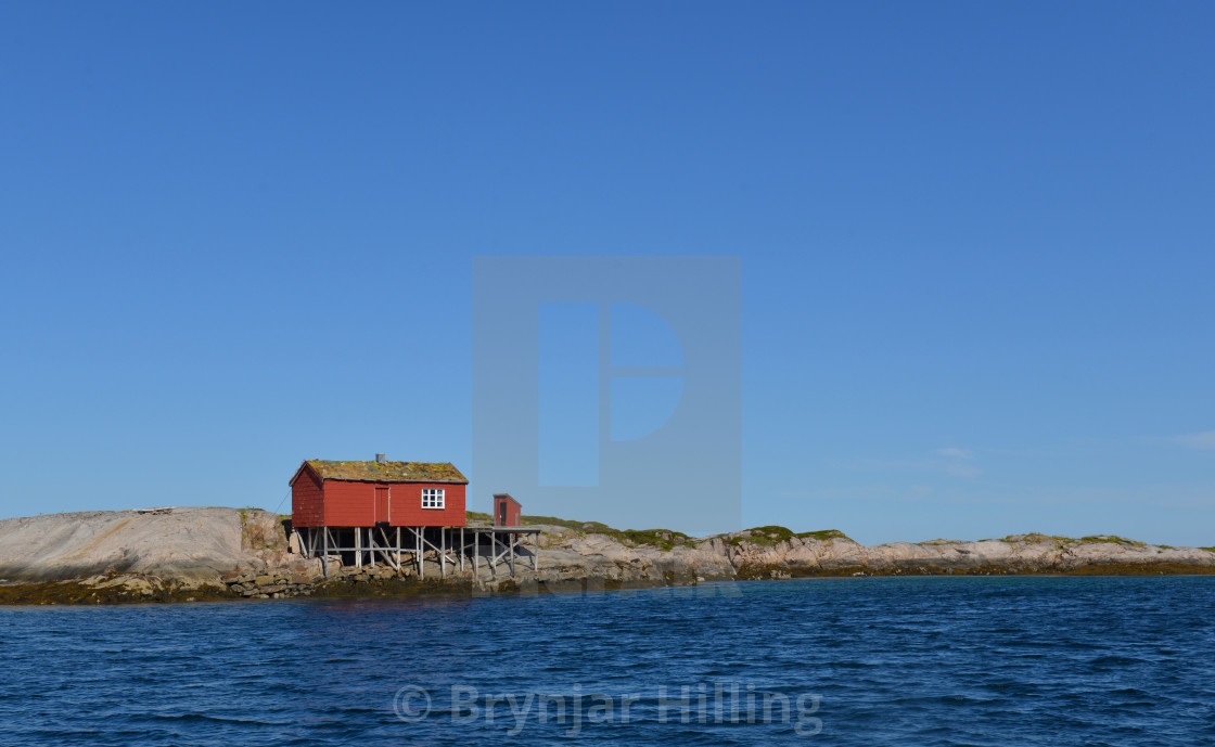 """fisherman shelter by the coast in Norway"" stock image"