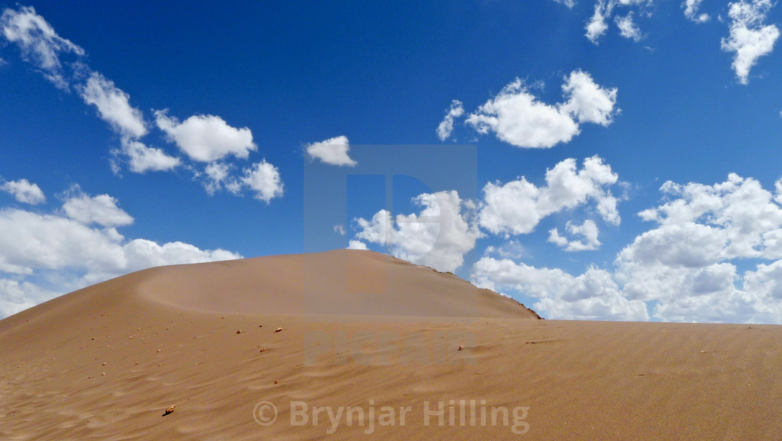 """Sand dune and blue skies"" stock image"
