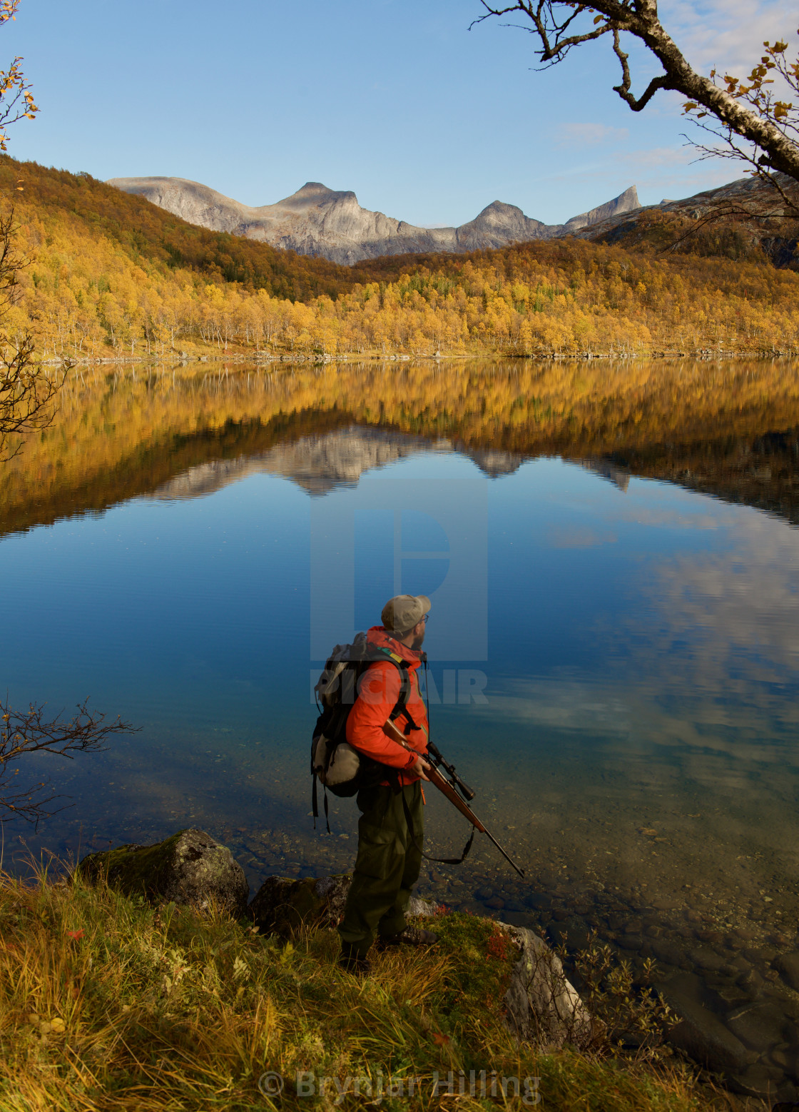 """Moose hunter Autumn lake"" stock image"